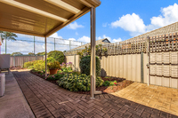 Two bedroom upgraded home with street frontage and spacious back garden.