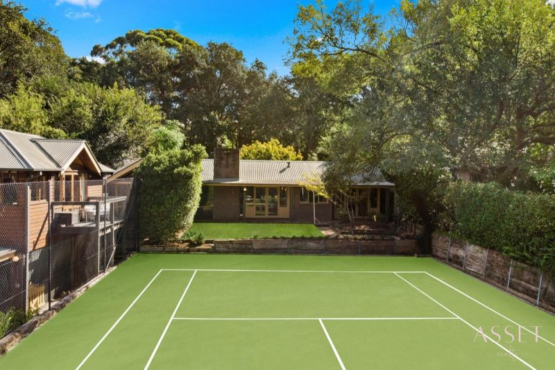 Idyllic Single Level Family Home with Tennis Court Set on 1,703sqm (approx.) Block of Level Land