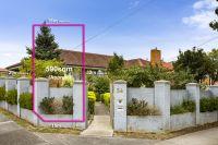 Enviably located corner block with original brick home