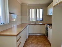 Modern and spacious, split level apartment with city views!
