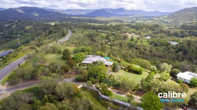 Wow what a view!!!   Low maintenance acreage property on 6.17 acres with 3phase power huge shed, solar and family home