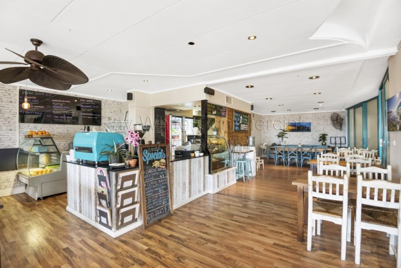 Beachfront Cafe Business For Sale - Scooters at Kirra