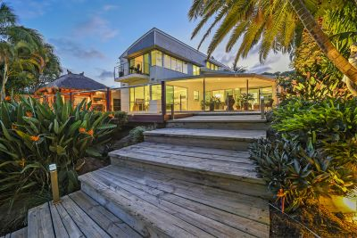 Exclusive designer waterfront with pool and jetty