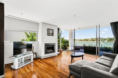 Prestige four bedroom + study waterfront home with intimate and uninterrupted water views