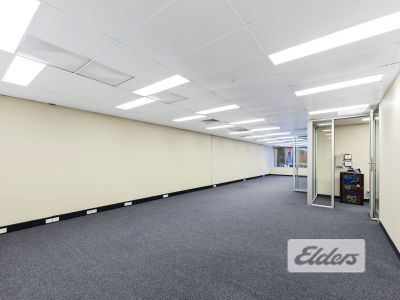 FIRST FLOOR OFFICE WITH HUGE WORKSTATION CAPACITY!
