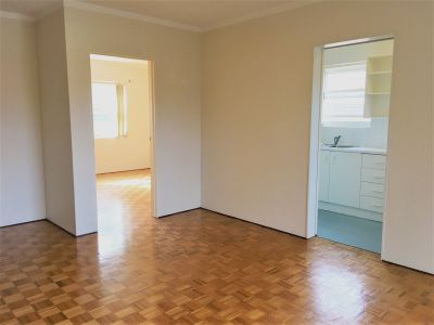 SPACIOUS, WELL LOCATED UNIT WITH GARAGE