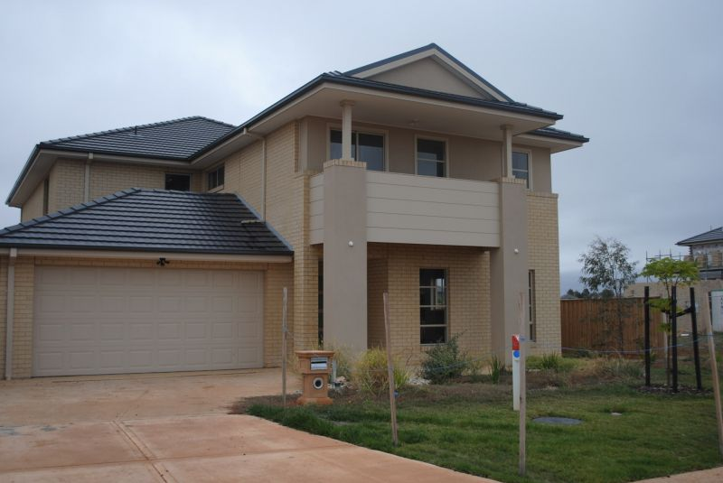 Stunning, Near New, Four Bedroom Home by the Lake!
