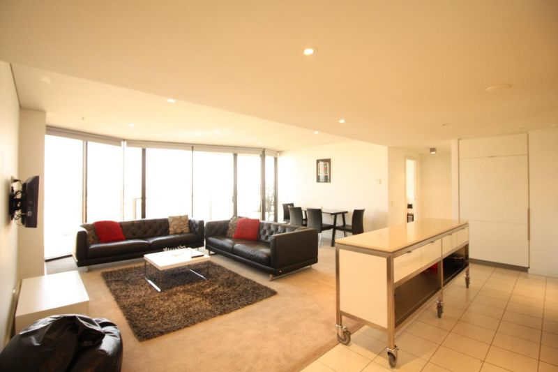 Your entry into highly sought Tower 5 with this Furnished two bedroom, two car space apartment
