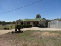 4.9 ACRES ¬ BLOCK HOME ¬ POOL- SHED