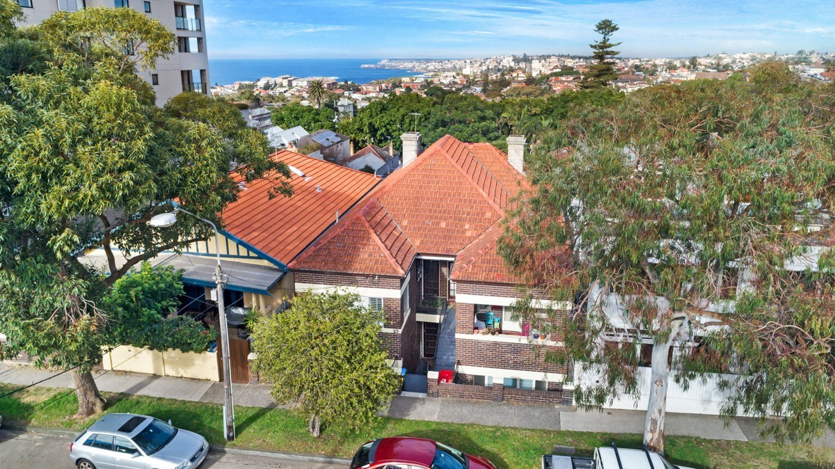 Whole Block of 4 apartments on 556m2 approx land with development potential STCA,  with water views.