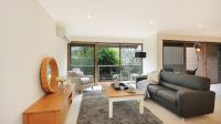Retire in style with open plan living and a private balcony