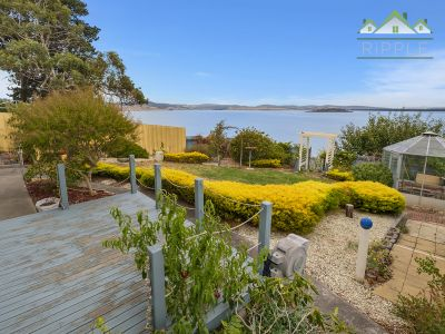 WATERFRONT ACCESS WITH ENORMOUS POTENTIAL!