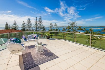 Luxurious Penthouse Living on the Broadwater with A Marina Berth!
