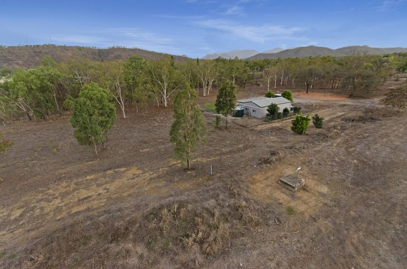 2 Hectares of Land with Caretakers Residence!