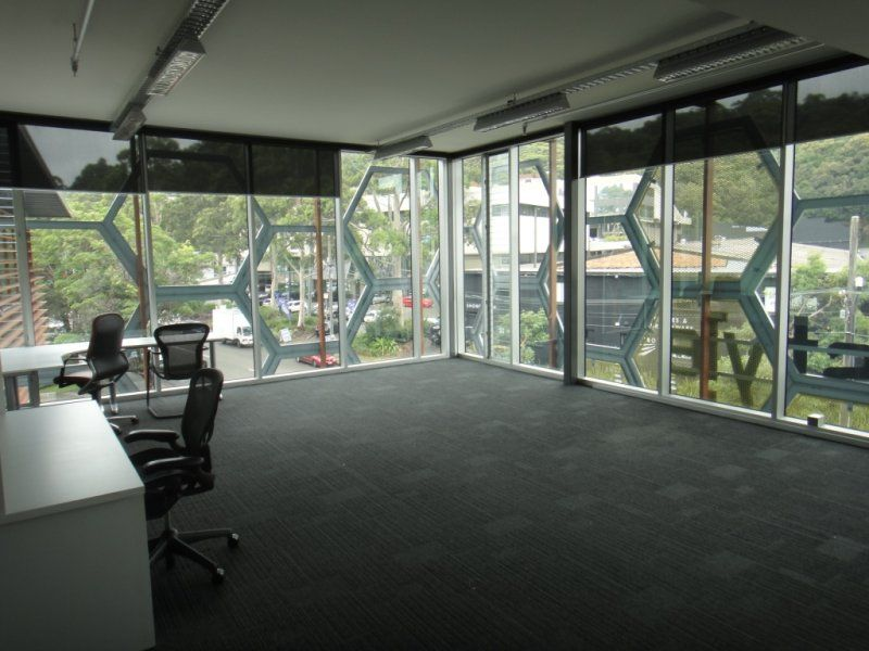 Light filled office space for lease in Brookvale with 3 metre floor to ceiling glass on two sides.