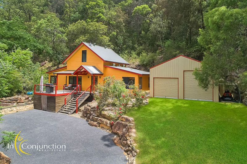 Enchanting 4/5 bedroom family home; picture-book setting on just over 1 acre with gorgeous river views just minutes to Wisemans Ferry.