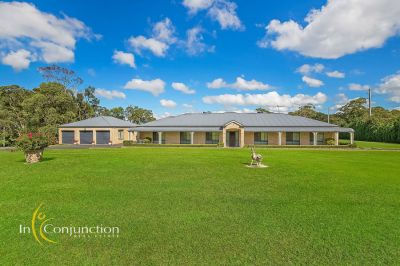 what everyone asks for!  immaculately presented single level 5 bedroom executive home on magnificent easy-care acres.