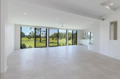 Nth East facing renovated Golf Course Home