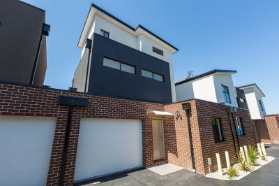 As New Three Level Townhouse With Lock Up Garage And Situated In This Small Attractive Unit Complex