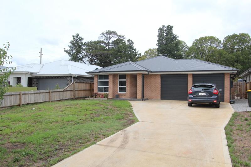NEAR NEW HOME IN SMALL ESTATE