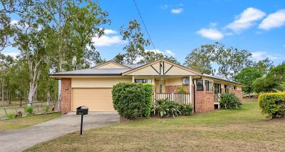 IMMACULATE BRICK HOME, FENCED WITH SHED