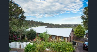 A HOUSE AMONGST THE GUM TREES WITH A VIEW