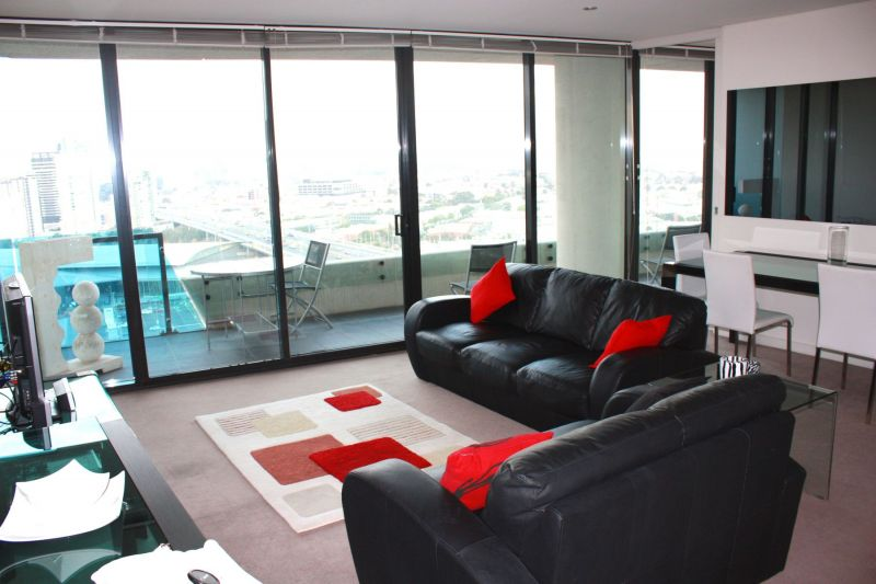 FULLY FURNISHED apartment with panoramic views of the CBD and Port Phillip Bay