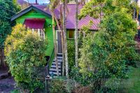 Glimpse City Views from this Eccentric Queenslander with Style to Match!