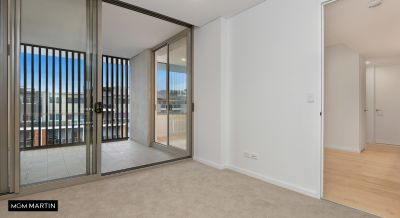 MARTIN- Two Bedroom + Private Rooftop Area
