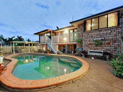 STYLISH BRICK HOME + POOL & SHEDS IN EXCELLENT LOCATION!