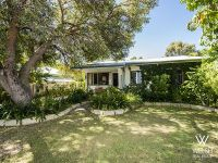Great starter home with DEVELOPMENT POTENTIAL!