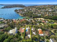 Substantial North Facing Harbourside Family Home Wiggleridge offers 1,276sqm of Level Land, Harbour Views + Beachside Location
