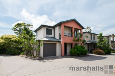 LOW MAINTENANCE TOWNHOUSE IN A PRIVATE COMPLEX