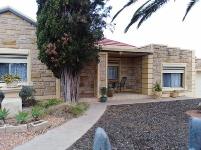 Two homes comprising 3 garages 4 kiitchens 3 bathrooms  &  Income potential