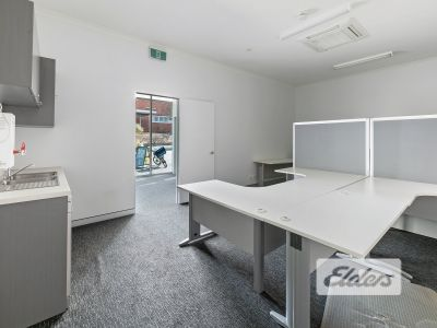 TIDY GROUND FLOOR OFFICE WITH HUGE EXPOSURE!