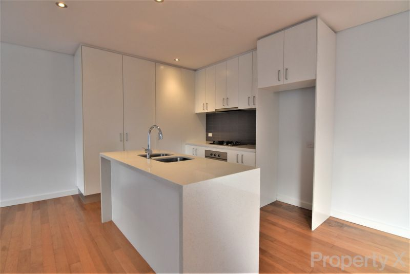 Two Bedroom Townhouse with Commercial Office/Study!