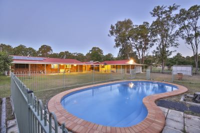 ARGUABLY BUNDY'S BEST ACREAGE BUY.....COMPLETE FAMILY PACKAGE!