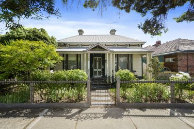 Classic Victorian Residence with Endless Potential!