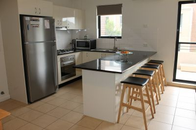 Renovated split level 2 bedroom apartment with loft style third bedroom