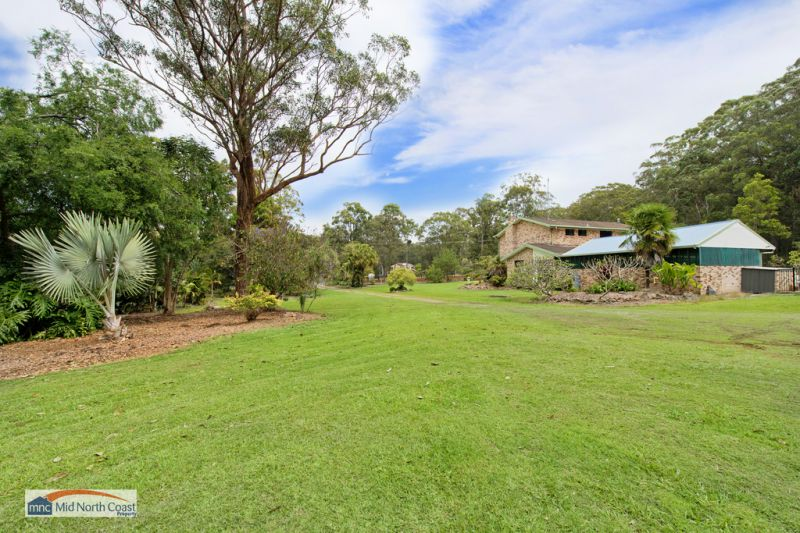 HOME ON OVER 2 ACRES 5 MINS TO BEACH