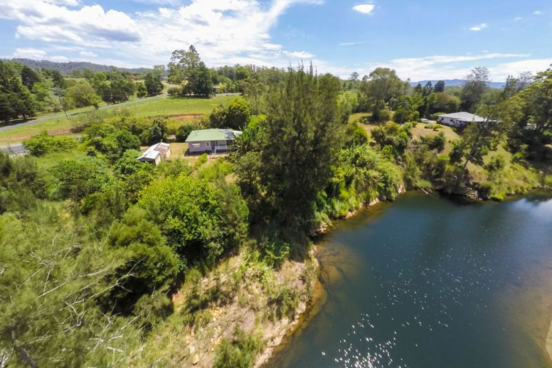 Rare Riverfront with Storybook Cottage