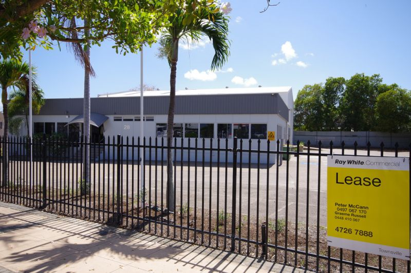Showroom / warehouse with security fenced hardstand on a main arterial road