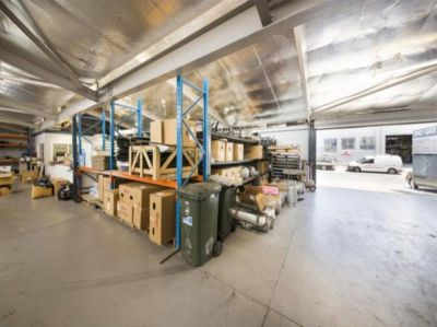 QUALITY WAREHOUSE ON HUGE LAND PARCEL!