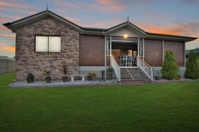 IMMACULATE HOME WITH 2 LIVING AREAS, LARGE SHED, 5KW SOLAR & STUNNING DECK!