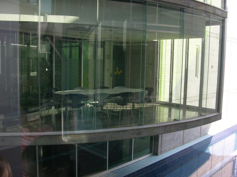 Light filled office space for Sale in Brookvale with 3 metre floor to ceiling glass on two sides.