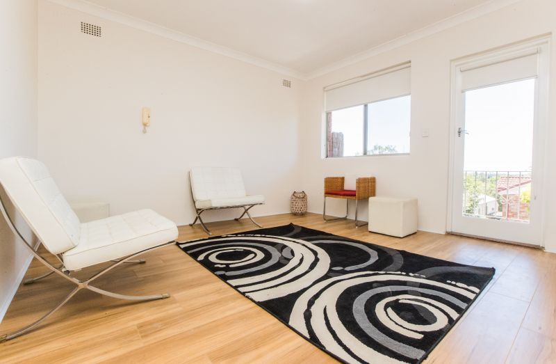 Freshly renovated, desirable, bright and sunny, 2 bedroom top floor security apartment with car space.