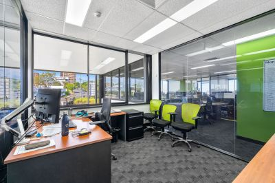 PROFESSIONAL OFFICE WITHIN HIGHLY EXPOSED ASSET!