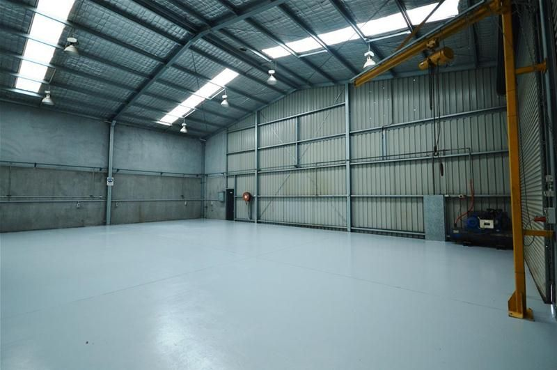 Immaculate Workshop With Dual Roller Doors
