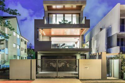 Tri-level Modern Masterpiece in Exclusive Beachfront Location