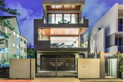 Tri-level Modern Masterpiece in Exclusive Beachfront Location